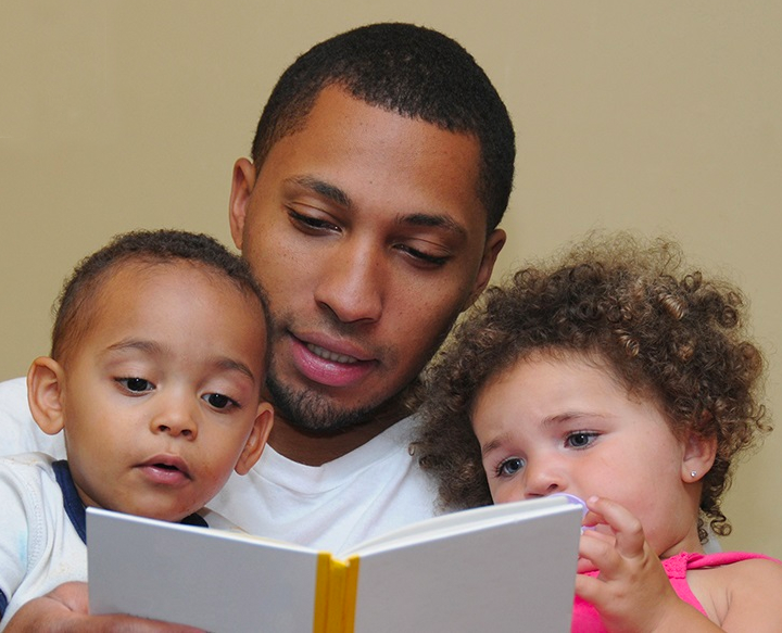 Dad reading to his kids