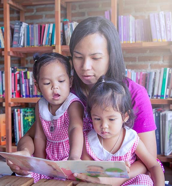 Mom and kids reading a book