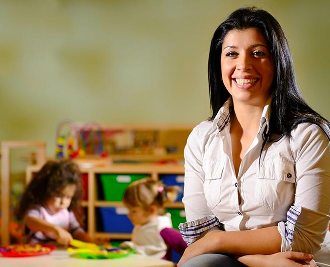 teacher with children in the background